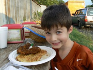 William Dooley and a plate of chicken and wafflers at Lucky J's