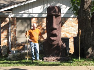 Herb Long next to his Easter Island Sculpture on Great Norther and Borden