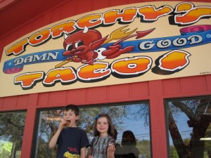 William and Kathryn Dooley in front of Torchy's Tacos on Anderson Lane