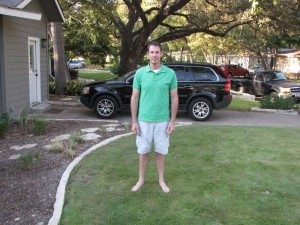Casey Burns barefoot on his Zorro Zoysia lawn